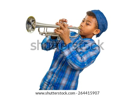 Boy trumpeter performs on stage. Famed musician plays solo on trumpet. - stock photo