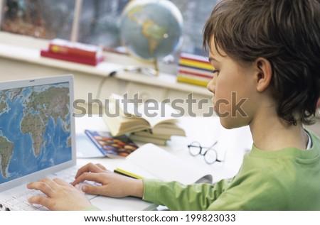 Boy using laptop - stock photo