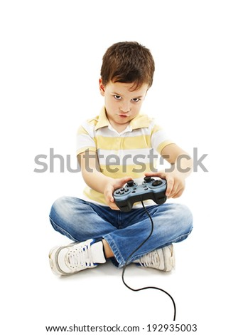 Boy using video game controller   Isolated on white background  - stock photo