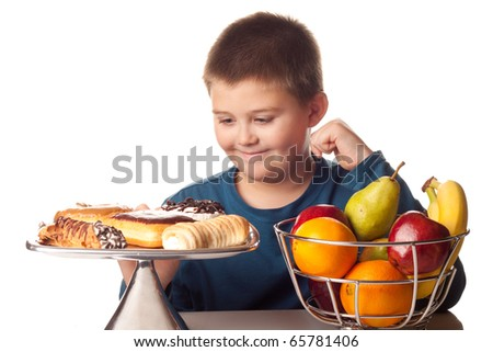 boy wanting a high calorie snack over a healthy fruit - stock photo