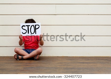 Boy wanting it to stop. - stock photo