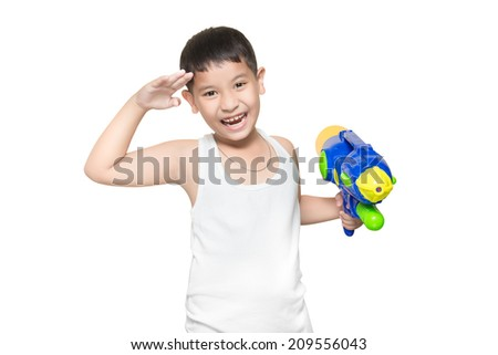 boy wearing a white vest, His holding a water gun and stand at salute very happy playing (for Songkran day). isolate on white background. - stock photo