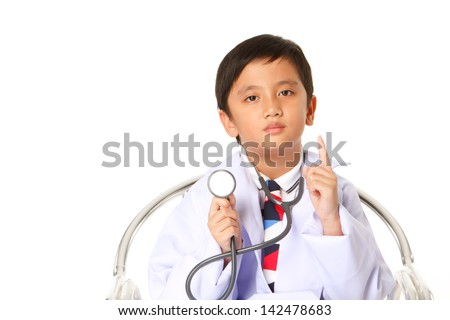 Boy wearing doctor with stethoscope. - stock photo