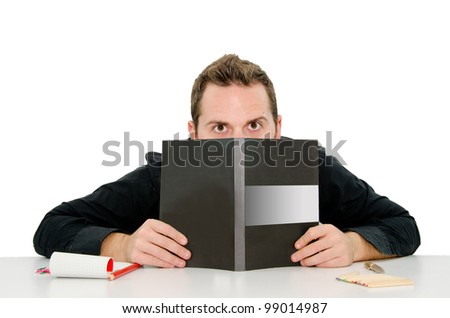 boy who hides behind a book - stock photo