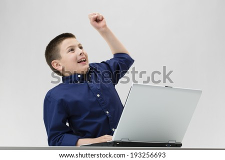Boy wining in playing computer games - stock photo