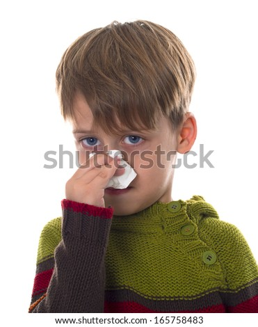 boy wipes his nose,  - stock photo