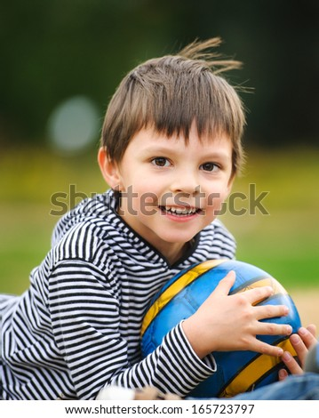 Boy with a ball - stock photo