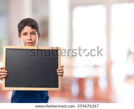 boy with a blackboard in a school - stock photo
