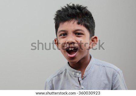 Boy with a cheering face - stock photo