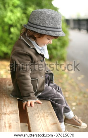 Boy with a hat, outdoor - stock photo