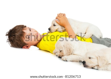 boy with a three puppy - stock photo