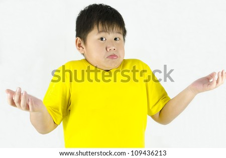 boy with a unsure, do not know expression - stock photo