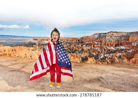 Boy with American flag, Bryce Canyon National Park - stock photo