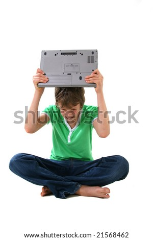 boy with angy expression holding computer - stock photo