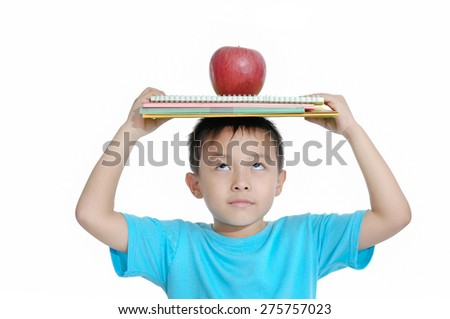 boy with apple and notebook isolated on white background - stock photo