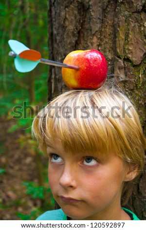 boy with apple on his head, looking up - stock photo