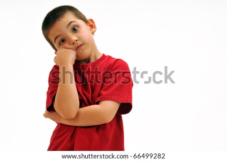 Boy with arm crossed and leaning his cheek on his fist feeling a little impatient and frustrated. - stock photo