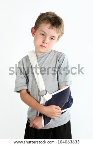 Boy with arm in a sling from a broken humerus - stock photo