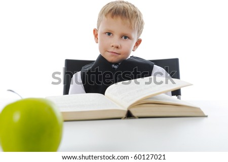 Boy with book. Isolated on white background - stock photo
