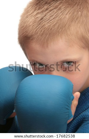 Boy with boxing gloves isolated on white. - stock photo