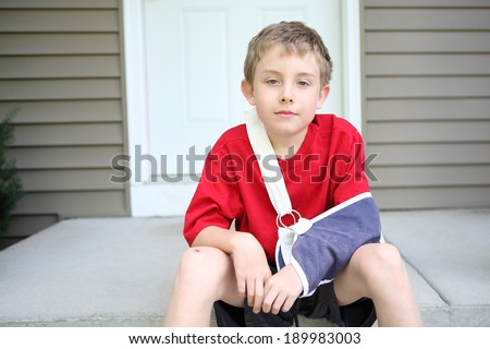 Boy with broken arm  - stock photo