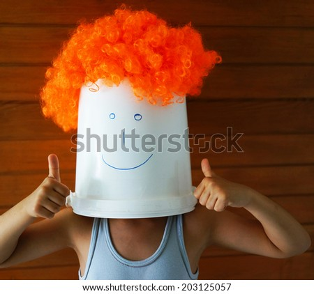 Boy with bucket on his head - stock photo