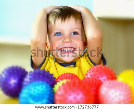 Boy with colorful balloons  - stock photo
