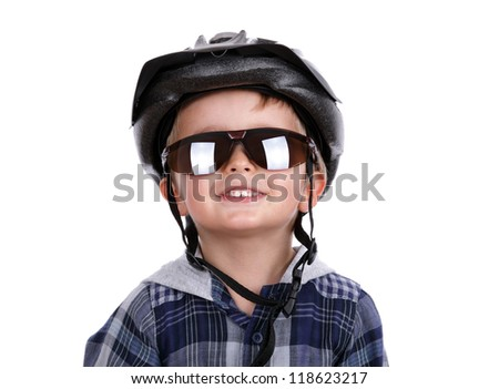 Boy with cycling helmet and dark sunglasses concept for child safety - stock photo