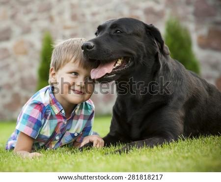 Boy with dog - stock photo