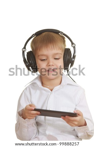 Boy with electronic pad and phones. Isolated on white - stock photo