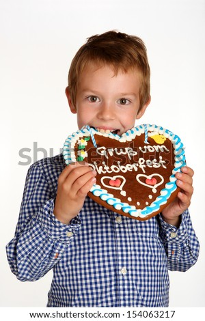boy with gingerbread heart - stock photo