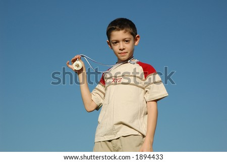 Boy with gold medal - stock photo