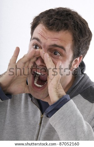 boy with hands in mouth, mouth open, screaming - stock photo