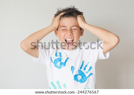 boy with hands in your hair that screams - stock photo