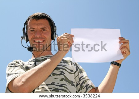 boy with headphones and blank board - stock photo