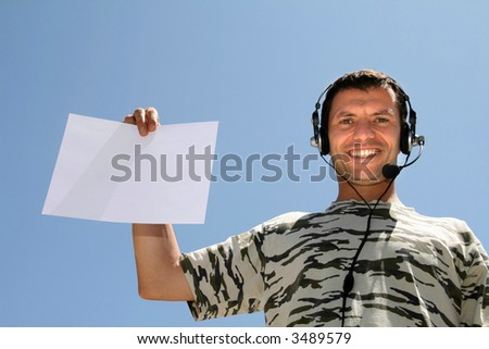 boy with headphones and white board - stock photo