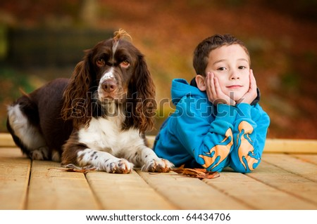 boy with his dog - stock photo