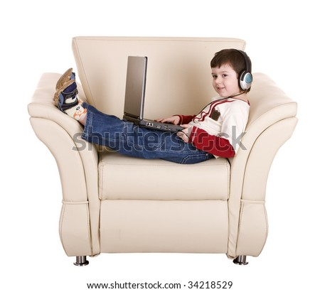 Boy with laptop and headphone. Isolated. - stock photo