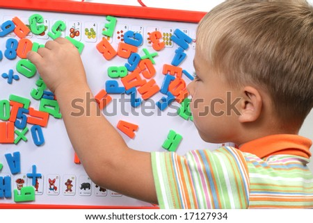 boy with magnet letters - stock photo