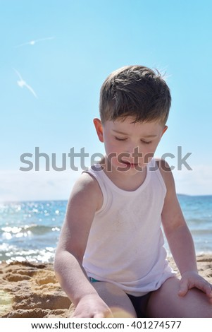 Boy with  on the beach - stock photo