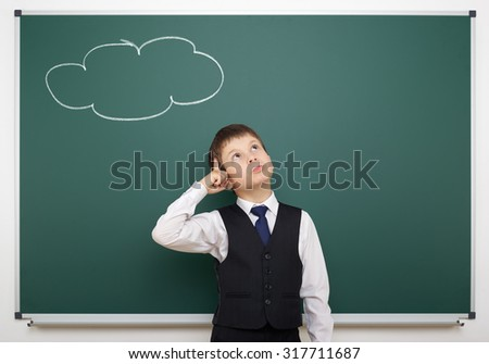 boy with painted cloud on board having idea - stock photo
