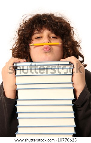 boy with pencil and books on white background - stock photo