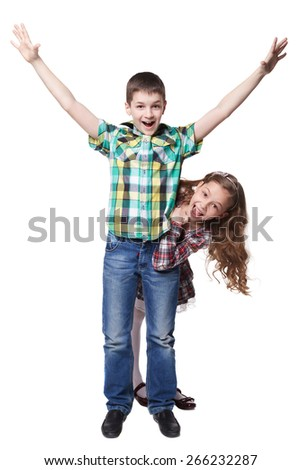 Boy with raised hands in colorful shirt and peeps girl isolated - stock photo