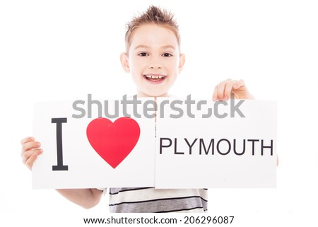 Boy with  sign I love Plymouth. Series of boy with English city signs - stock photo