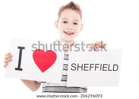 Boy with  sign I love Sheffield  . Series of boy with English city signs - stock photo