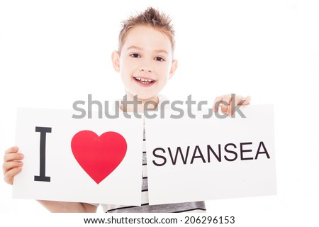 Boy with  sign I love Swansea. Series of boy with English city signs - stock photo