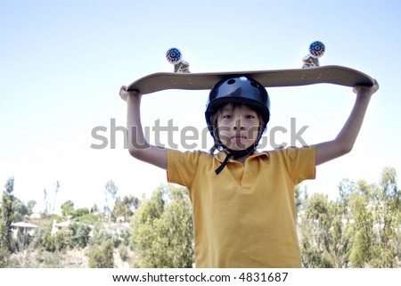 Boy with Skateboard - stock photo