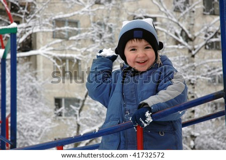 boy with snowball - stock photo