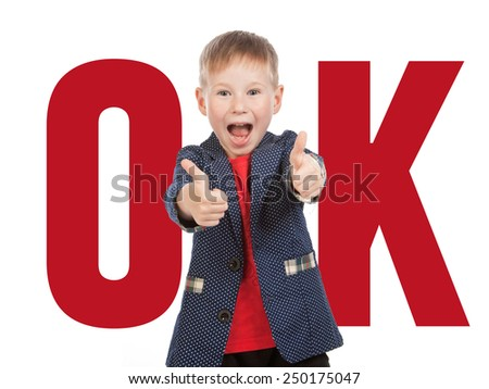 """Boy with thumbs up in """"ok"""" gesture, isolated - stock photo"""
