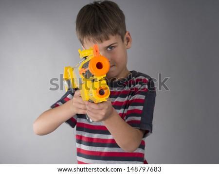 boy with toy gun - stock photo